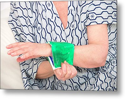 Woman With A Cold Compress On Wrist Metal Print
