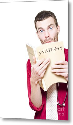 Young Medical Intern Student Studying Anatomy Book Metal Print by Jorgo Photography - Wall Art Gallery