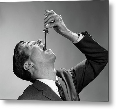 1960s Man In Suit And Tie Swallowing Metal Print