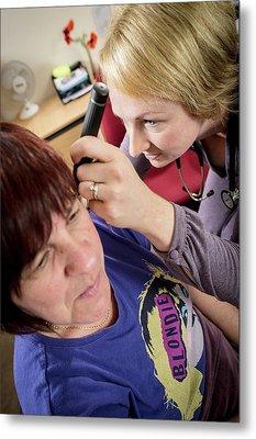 Gp Examining Patient Metal Print by Jim Varney