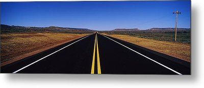 Highway Passing Through A Landscape Metal Print by Panoramic Images