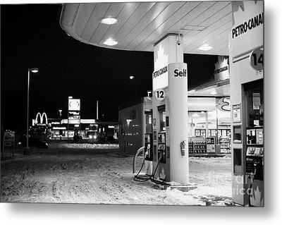 petro canada winter gas fuel pump at service station Regina Saskatchewan Canada Metal Print by Joe Fox