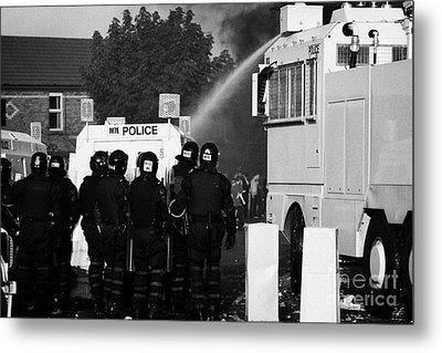 Psni Riot Officers Behind Armoured Land Rover And Water Cannon On Crumlin Road At Ardoyne Shops Belf Metal Print by Joe Fox