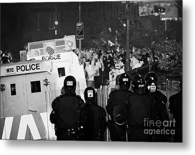Psni Riot Officers Face Rioters Mob On Crumlin Road At Ardoyne Shops Belfast 12th July Metal Print by Joe Fox