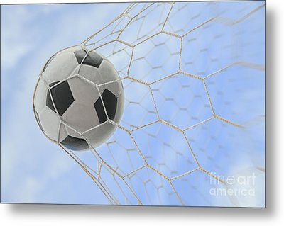 Soccer Ball In Goal Metal Print by Anek Suwannaphoom