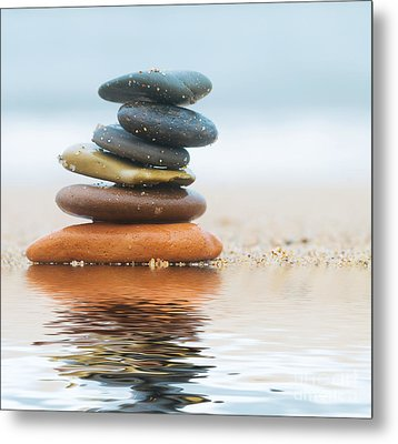 Stack Of Beach Stones On Sand Metal Print by Michal Bednarek