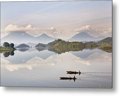 Dugout Canoe Floating On Lake Mutanda Metal Print by Martin Zwick