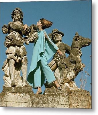 Model Standing Between Statues At The Villa Metal Print