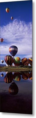 Reflection Of Hot Air Balloons Metal Print by Panoramic Images