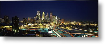 Buildings Lit Up At Night In A City Metal Print by Panoramic Images