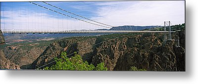 Suspension Bridge Across A Canyon Metal Print by Panoramic Images
