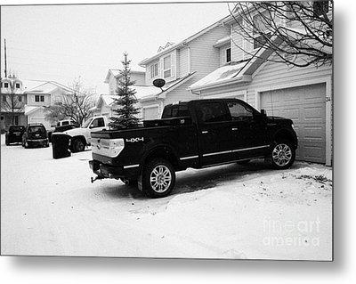 4x4 Pickup Trucks Parked In Driveway In Snow Covered Residential Street During Winter Saskatoon Sask Metal Print by Joe Fox