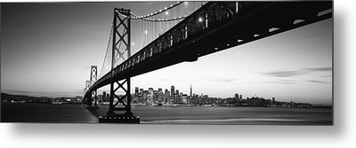 Bridge Across A Bay With City Skyline Metal Print