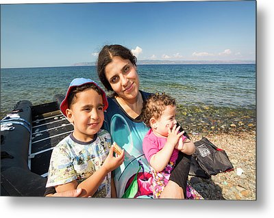 Syrian Refugees Arriving On Greek Island Metal Print by Ashley Cooper