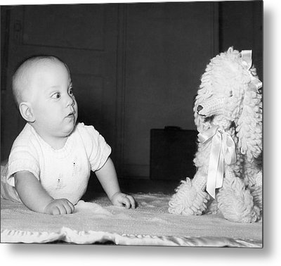 A Baby And A Toy Dog Metal Print by Orville Andrews