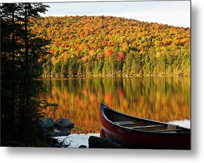 A Canoe On The Shoreline Of Pond Metal Print by Jerry and Marcy Monkman