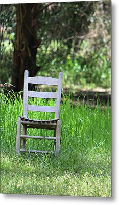 A Chair In The Grass Metal Print by Lynn Jordan
