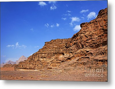 A Landscape Of Rocky Outcrops In The Desert Of Wadi Rum Jordan Metal Print by Robert Preston