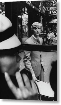 Woman In Telephone Booth Watched By Man Metal Print by Horn and Griner