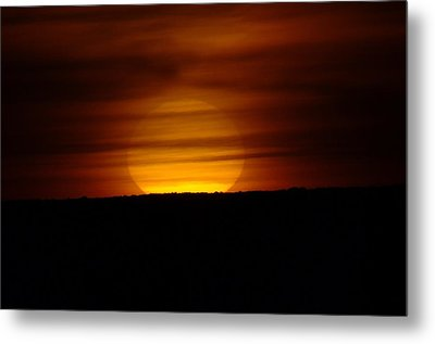 A Misted Sunset Metal Print by Jeff Swan