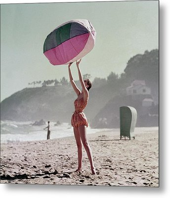 A Model Wearing A Bathing Suit Holding Up An Metal Print