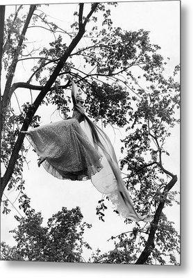 A Model Wearing A Dress In A Tree Metal Print by Gene Moore