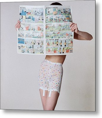 A Model Wearing A Girdle With A Comic Metal Print