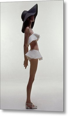 A Model Wearing A Two Piece Bathing Suit Metal Print