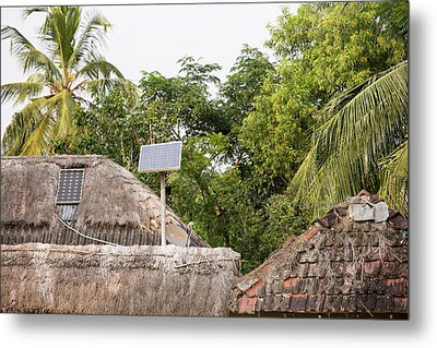 A Mud Hut With A Small Solar Panel Metal Print by Ashley Cooper