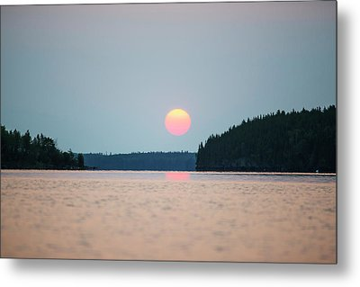 A Red Sun Setting Over The Forest Metal Print by Thomas Fricke