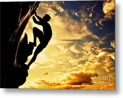 A Silhouette Of Man Free Climbing On Rock Mountain At Sunset Metal Print by Michal Bednarek