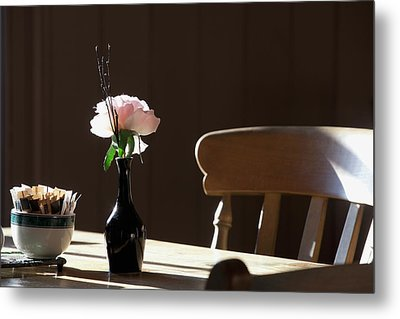 A Single Rose Sits In A Small Vase Metal Print by John Short