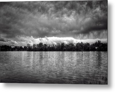A Storm Rolls By Metal Print by Thomas Young