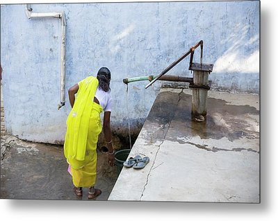 A Water Pump At The Barefoot College Metal Print by Ashley Cooper
