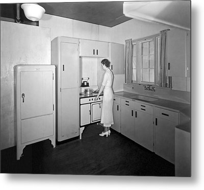 A Woman In Her Kitchen Metal Print
