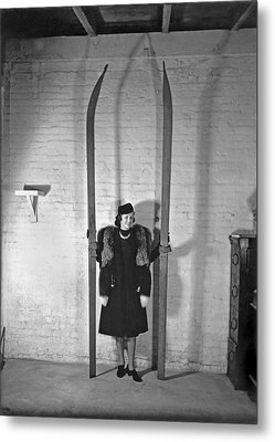 A Woman With Nine Foot Skis Metal Print by Underwood Archives