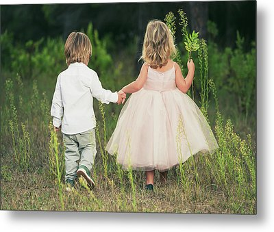 A Young Boy And Young Girl Holding Metal Print