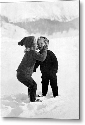 A Young Girl Gives Her Little Brother A Kiss On The Cheek In The Snow Metal Print by Unknown Photographer