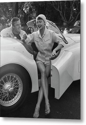 A Young Model Sitting In A Convertible Sports Car Metal Print by Karen Radkai