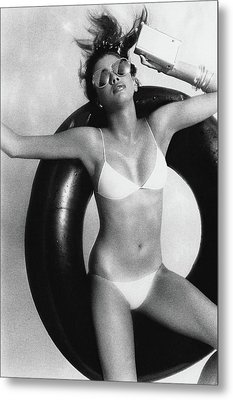 A Young Woman Floating On An Inner Tube Metal Print