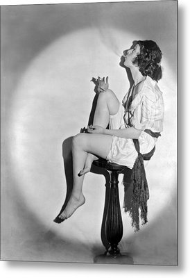 A Young Woman Smoking Metal Print by Underwood Archives