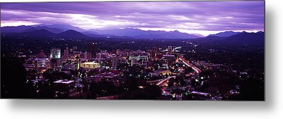 Aerial View Of A City Lit Up At Dusk Metal Print