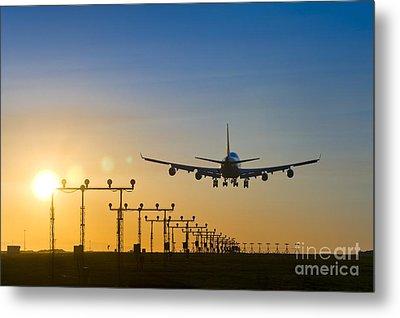 Airplane Landing At Sunset, Canada Metal Print by David Nunuk