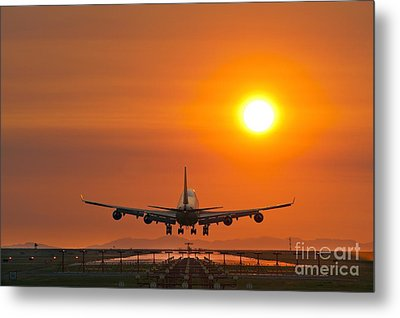 Airplane Landing At Sunset Metal Print