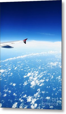 Airplane Wing Against Blue Sky Horizon Metal Print by William Voon