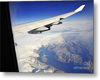 Airplane Wing Over Snowy And Rocky Coastline Metal Print