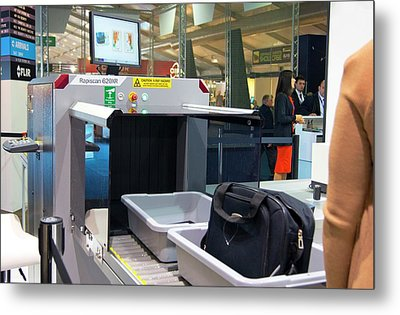 Airport Baggage X-ray Scanner. Metal Print by Mark Williamson