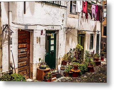 Alfama Houses Metal Print by Paul Donohoe