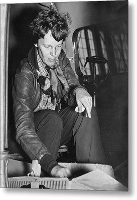 Amelia Earhart Checks Supplies Metal Print by Underwood Archives