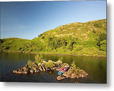An Inflatable Kayak On Ullswater Metal Print by Ashley Cooper